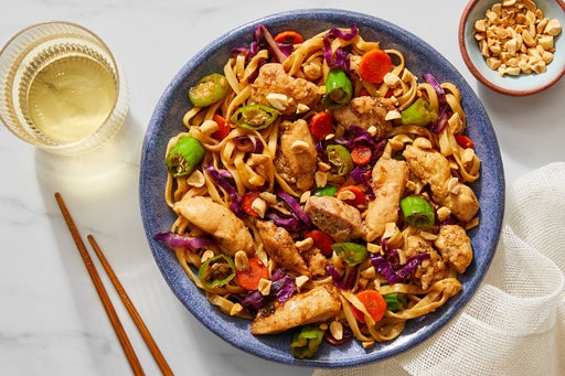 Chicken & Wonton Noodle Stir-Fry With Carrots, Cabbage & Shishito Peppers