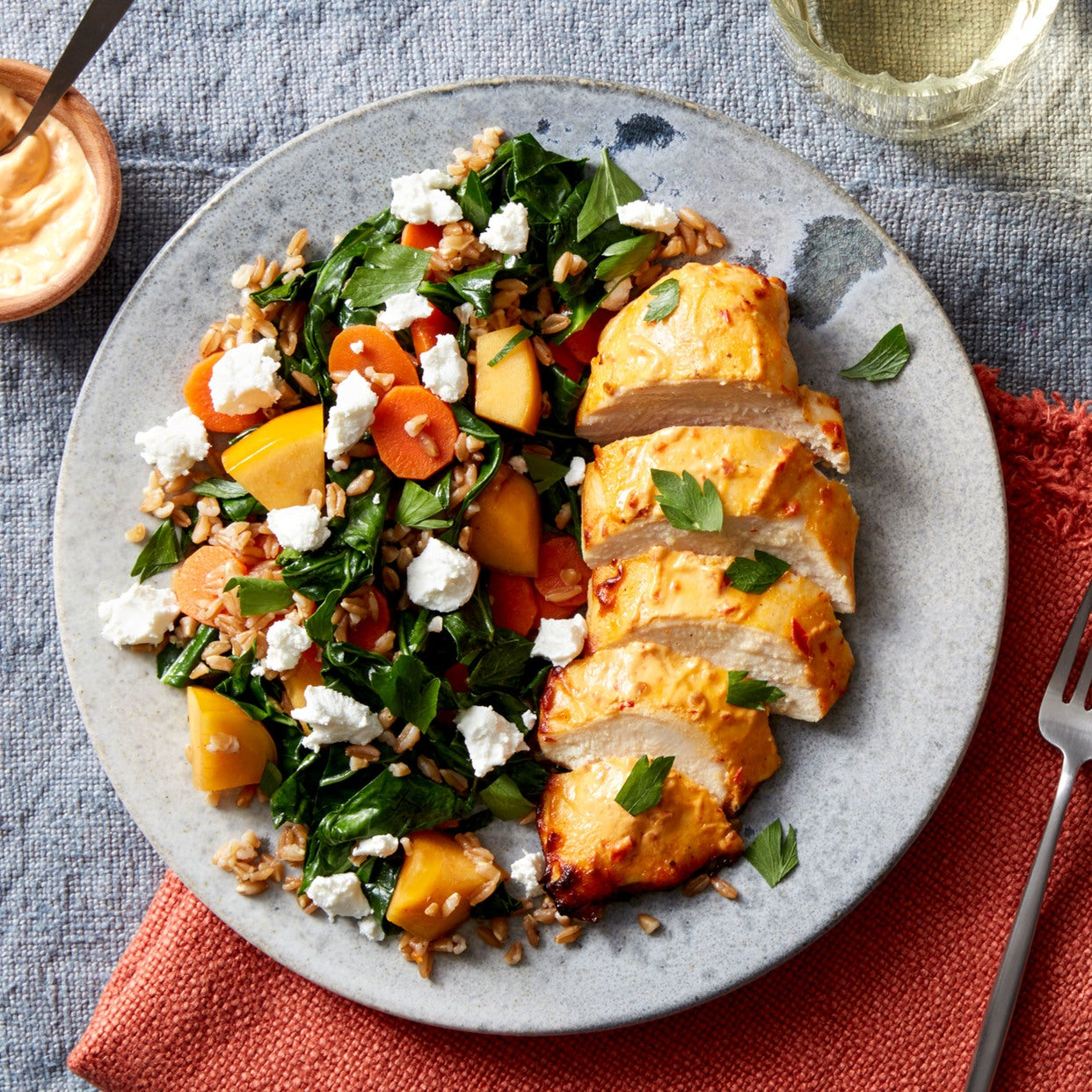 Harissa-Baked Chicken with Farro, Persimmon, & Goat Cheese Salad
