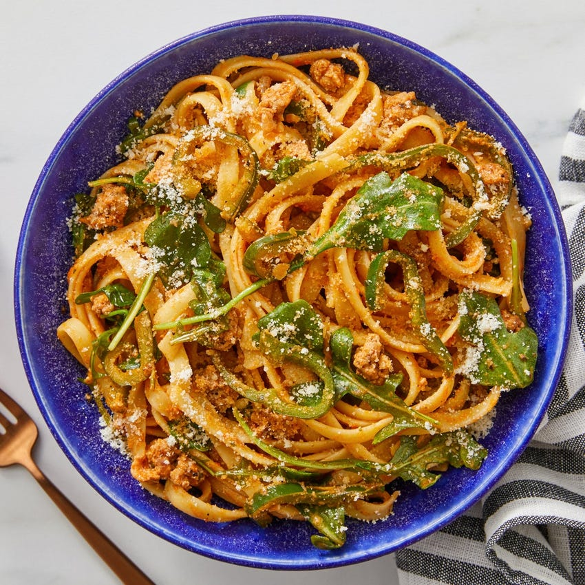 Tuscan Pork Pasta with Romesco Sauce & Arugula