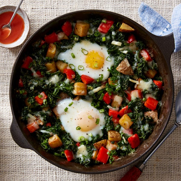 Crispy Potato & Kale Hash with Baked Eggs & Aged Alpine Cheese