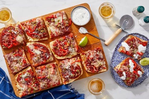Pepper & Onion Flatbread with Tomato-Guajillo Sauce & Creamy Lime Dressing