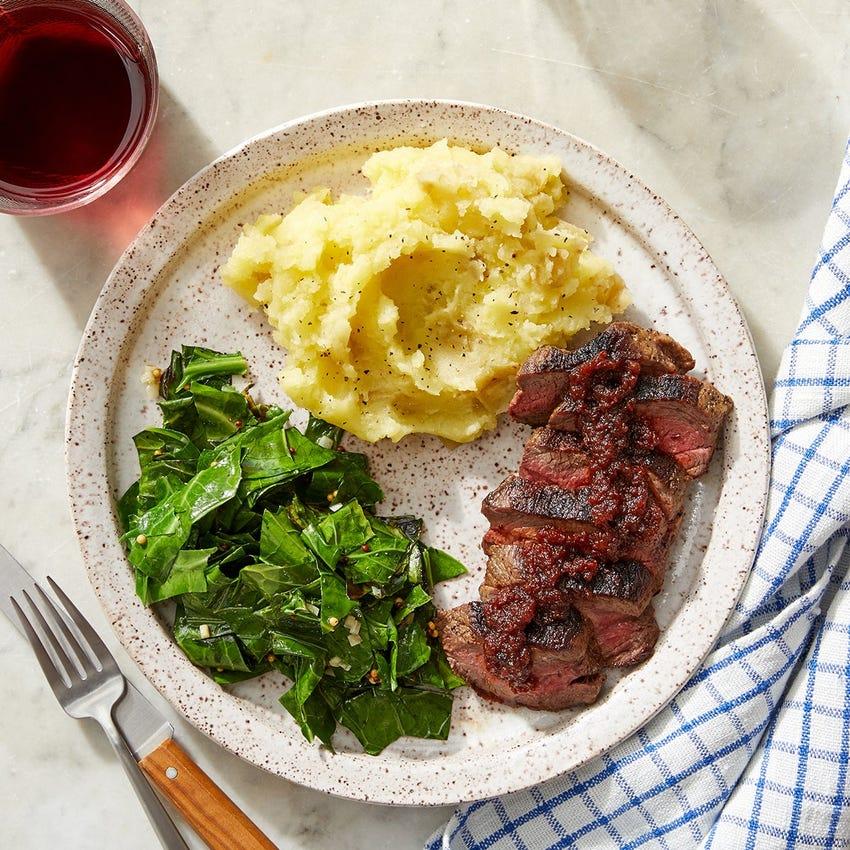 Steaks & Tomato Chutney Pan Sauce with Mashed Potatoes & Collard Greens