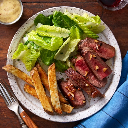 Seared Steaks & Garlic Butter with Oven Fries & Salad