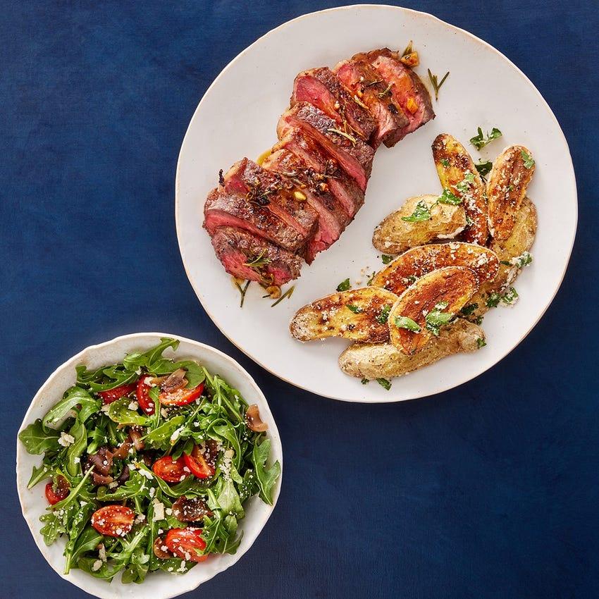 Pan-Seared Strip Steaks & Rosemary-Butter Sauce with Arugula Salad & Garlic-Parmesan Potatoes