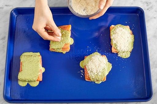 Make the pesto mayo & coat the fish