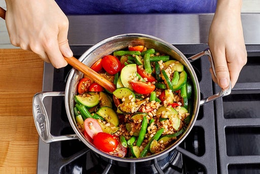 Cook the remaining vegetables & finish the farro