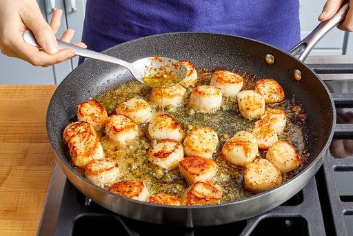 Cook & baste the scallops