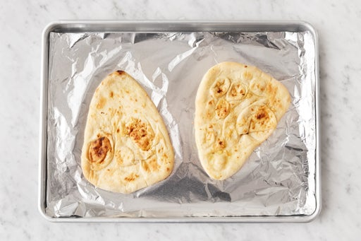 Make the garlic naan & plate your dish: