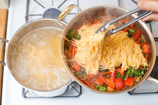 Cook the noodles & finish the stir-fry: