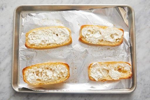 Make the cheesy garlic bread