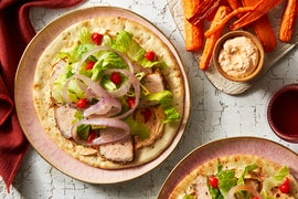 Sheet Pan Pork Pitas with Carrot Fries & Harissa Yogurt