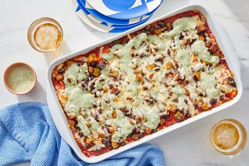 Cheesy Baked Tortilla Pie with Guajillo Tomato Sauce, Mushrooms & Chayote Squash