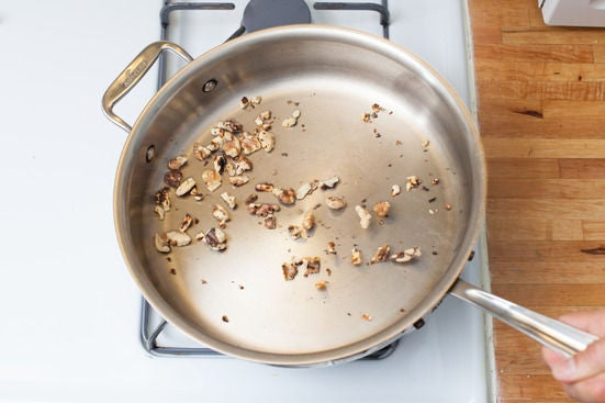Toast the walnuts: