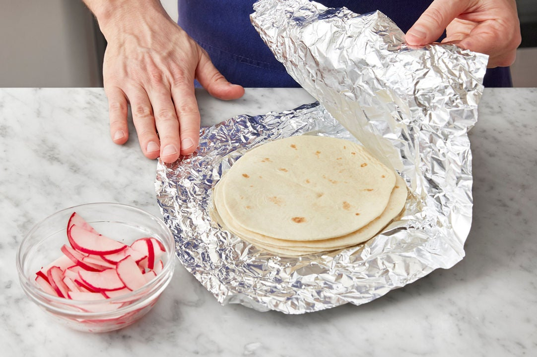 Warm the tortillas & season the radishes: