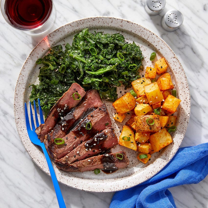 Steaks & Black Bean-Butter Sauce with Miso Kale & Spicy Roasted Potatoes