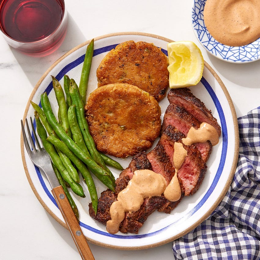 Mexican-Spiced Steaks & Creamy Chipotle Sauce with Cheddar-Jalapeño Potato Cakes