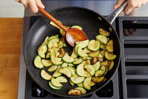 Cook the zucchini & finish the quinoa