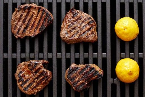 Grill the steaks & lemon