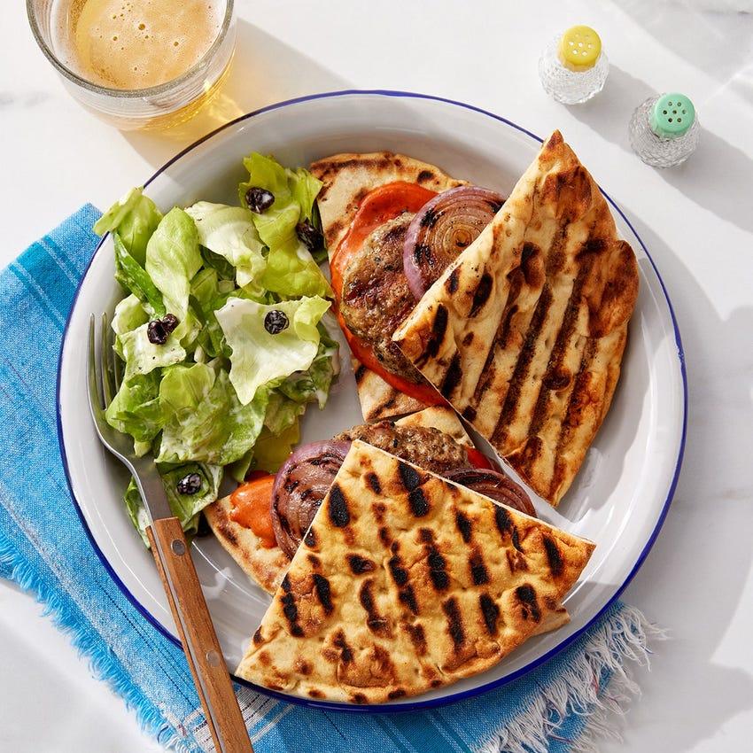 Grilled Pork Pita Burgers with Harissa Mayo & Red Onion