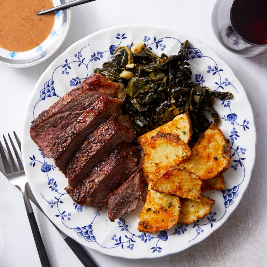Strip Steak & Potatoes with Spicy Maple Collard Greens