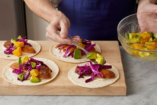 Warm the tortillas & serve your dish: