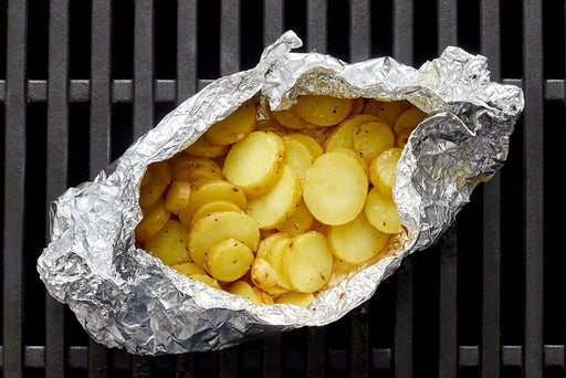 Make the foil packet & grill the potatoes