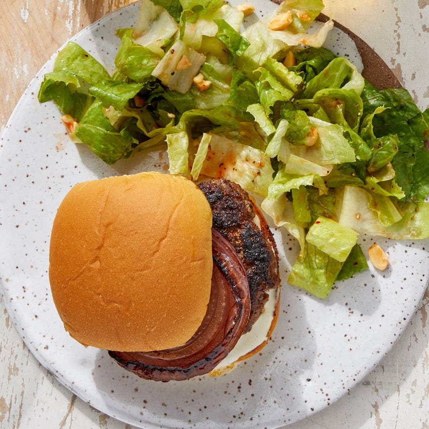 Grilled Beyond Burger™ with Lime Mayo, Grilled Onion & Sweet-Chili Dressed Salad