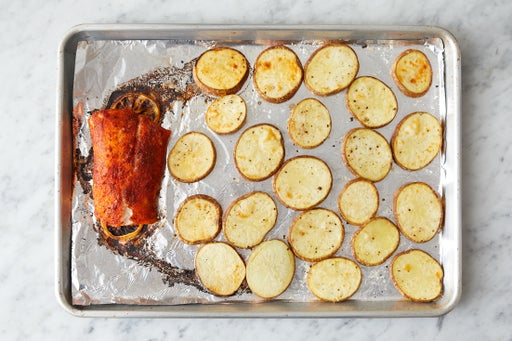 Bake the potatoes & fish: