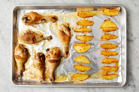 Roast the potatoes & chicken: