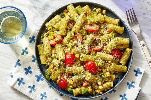 Pesto Pasta & Corn with Fresh Tomatoes & Parmesan Cheese