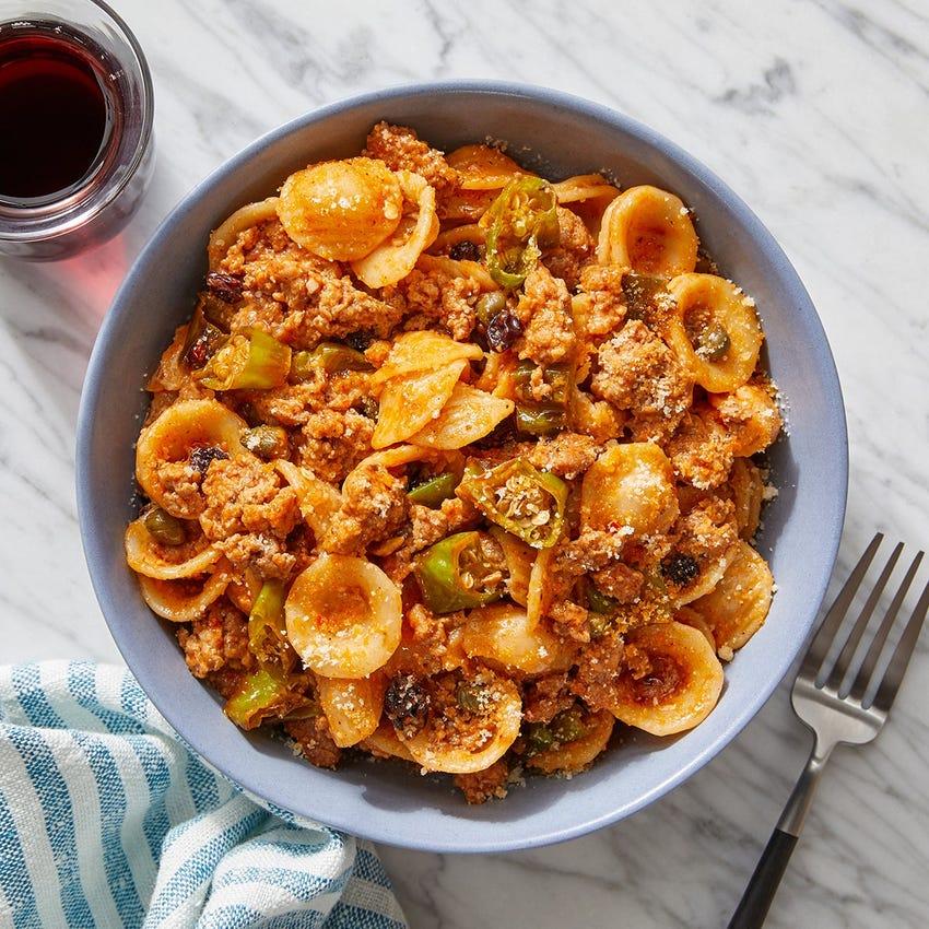 Ground Pork Ragù & Orecchiette Pasta with Currants & Shishito Peppers