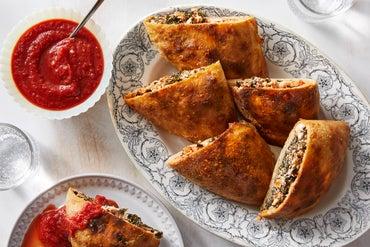Three-Cheese Calzones with Kale & Golden Raisins