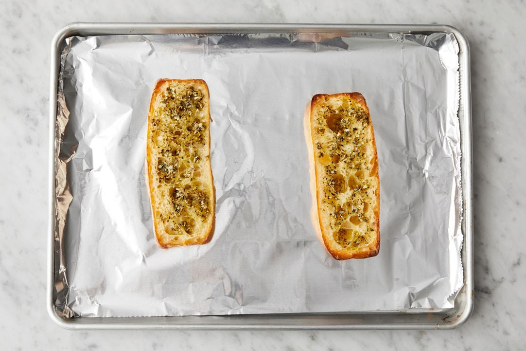 Make the garlic bread: