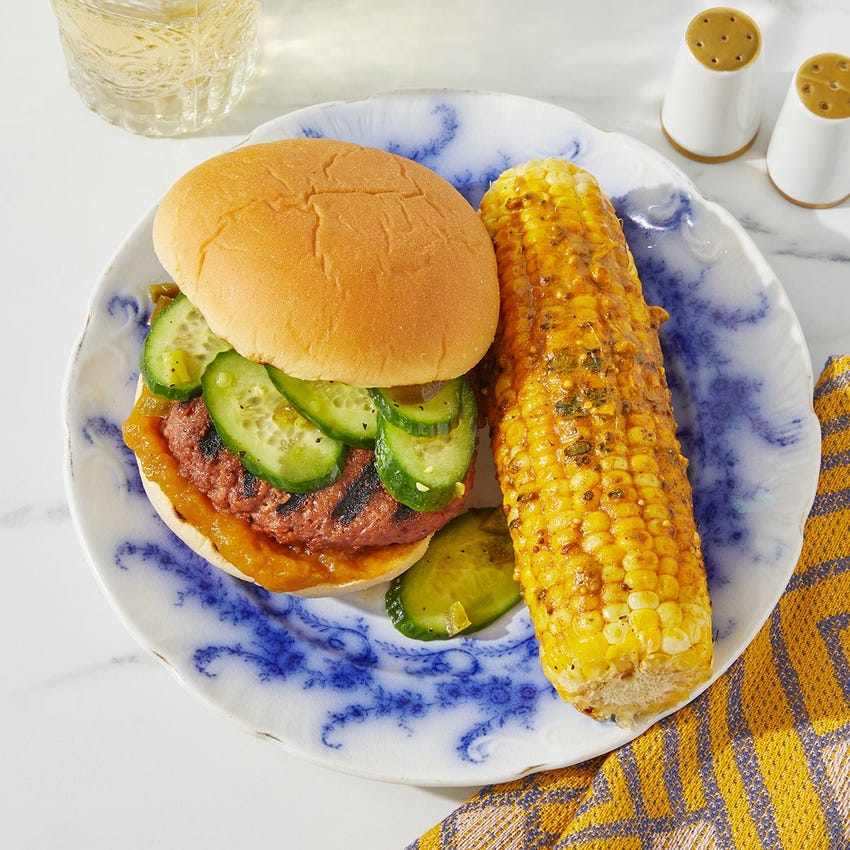 Grilled Indian-Style Beyond Burger™ with Curry Corn on the Cob