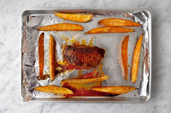 Roast the pork & sweet potatoes: