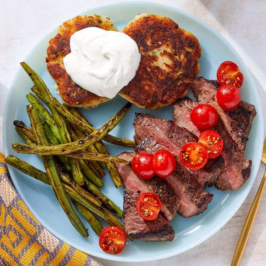 Pan-Seared Steaks & Green Beans with Sour Cream & Cheesy Scallion Potato Cakes