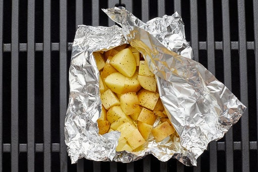 Assemble the foil packet & grill the potatoes