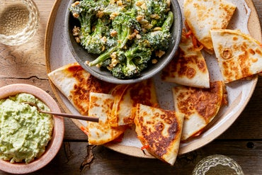 Spicy Pepper & Onion Quesadillas with Roasted Broccoli Salad