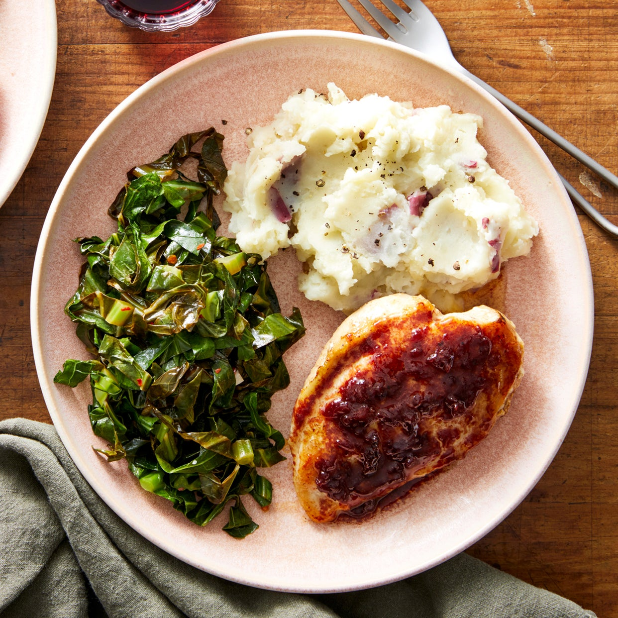 Cherry-Glazed Chicken with Garlic Mashed Potatoes & Braised Collard Greens