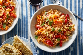 Mafalda Pasta in Creamy Roasted Pepper-Tomato Sauce with Cheesy Bread