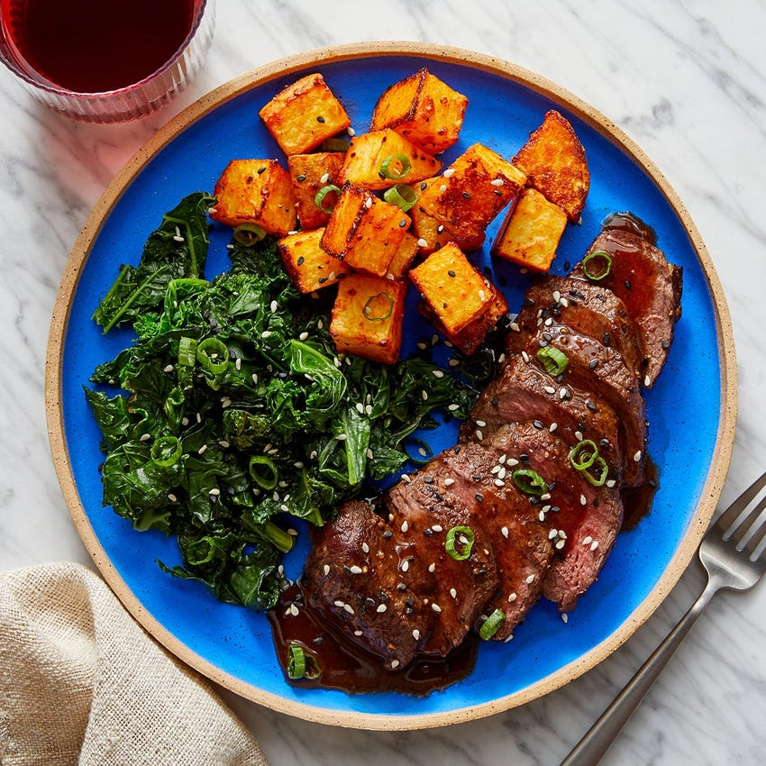 Steaks & Black Bean-Butter Sauce with Miso Kale & Gochujang Potatoes