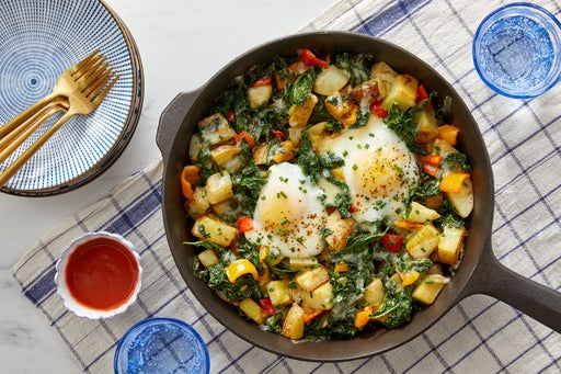 Potato Hash & Eggs with Kale, Sweet Peppers & Hot Sauce