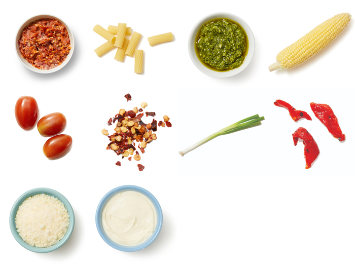 Pesto Pasta & Corn with Fresh Tomatoes & Romano Cheese