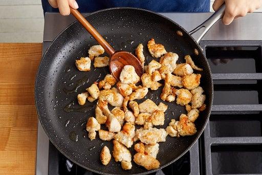 Coat & cook the chicken