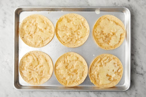 Make the cheesy tortillas & serve your dish: