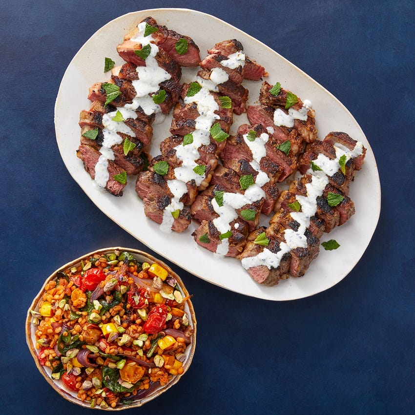 Shawarma-Spiced Strip Steaks with Sesame Labneh & Roasted Vegetable Barley