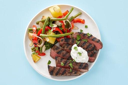 Finish & serve the Grilled Steak & Lemon Labneh