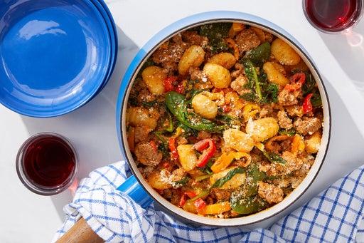 Tuscan Pork & Gnocchi with Spinach & Romesco-Tomato Sauce
