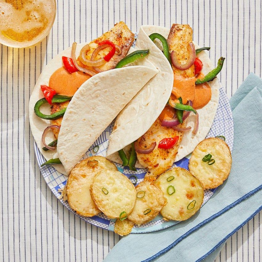Tilapia Fish Tacos with Guajillo Sour Cream & Cheesy Potatoes