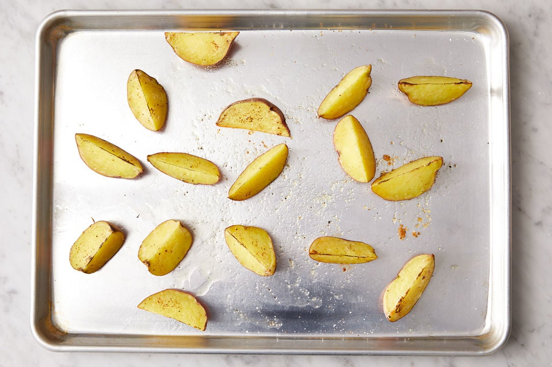 Roast the potatoes: